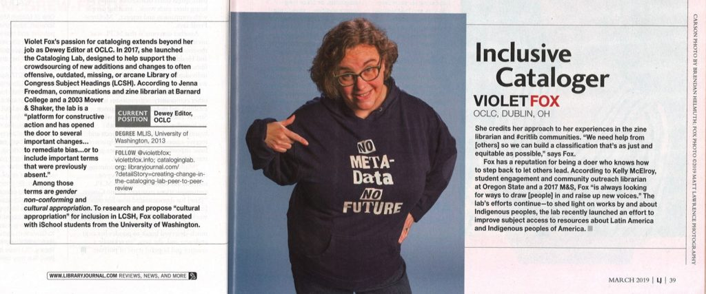 "magazine spread of story reading ""Violet Fox, Inclusive Cataloger"" (available at the link) and a photo of Violet wearing a ""no metadata, no future"" sweatshirt"